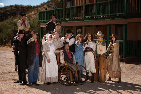 Large group of men and women in old west theme with guns photo