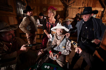 Sheriff and cowboys with weapons on cheating gambler