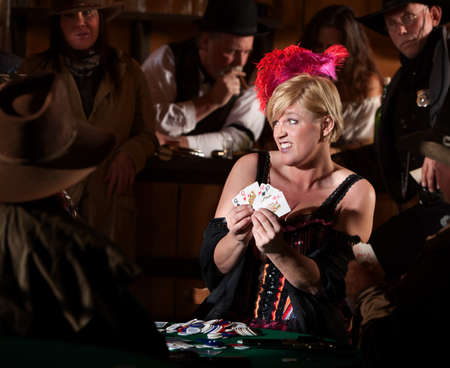Embarrassed bar maid with playing cards in old west saloon