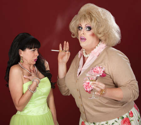 Disgusted lady reacts to drag queen smoking cigarette Stock Photo - 13791228