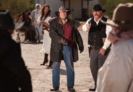 Angry male and female gunfighters pull out their weapons photo