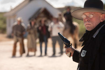 Outgunned sheriff in old American west showdown photo