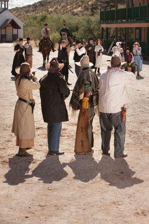 Rowdy: Dangerous gunfight outside in old American west scene Stock Photo