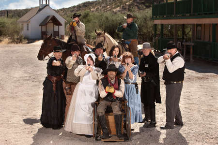 Group of old American west townspeople with weapons photo