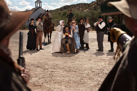 Townspeople under attack from bandits in old west scene photo