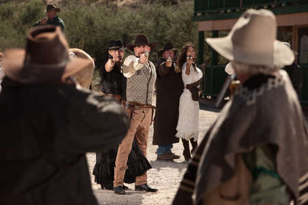 Old American west shoot out on dusty street  photo