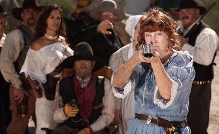 gunfighter: Brave grandmother points her double barrel shotgun