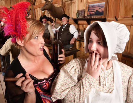 Two ladies gossiping in an American old west tavern Stock Photo - 13791229