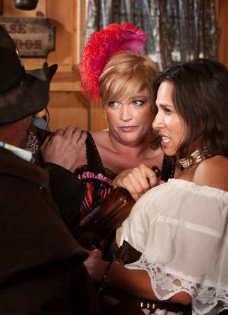 disgusted: Disgusted women react as cowboys try to touch them