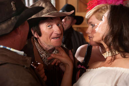 tickling: Pretty women tease middle aged cowboy in tavern