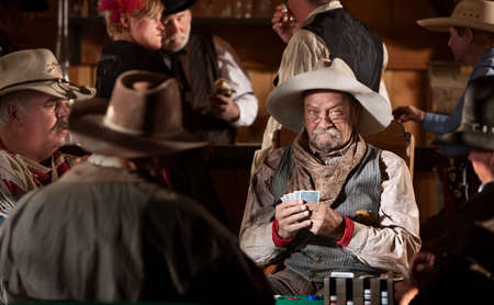 Man with poker face in American old west scene photo
