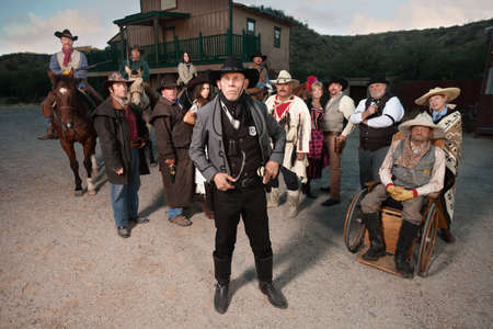 Sheriff in front of group in old American west theme photo