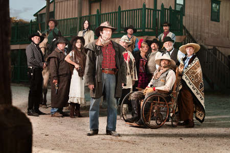 old man beard: Tough cowboy with group of people in old west costumes