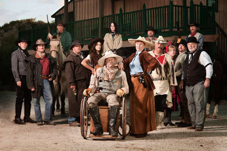 Old west theme Senior couple with group of people photo