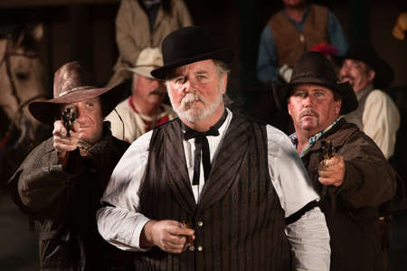 Tough old west gambler with armed friends Stock Photo - 13791165