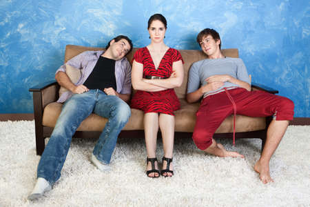 Annoyed woman between two infatuated young men