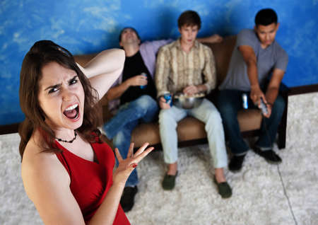 hysterical: Caucasian woman annoyed with three men playing video games