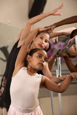 ballet dancing: Ballet students stretch out and warm up