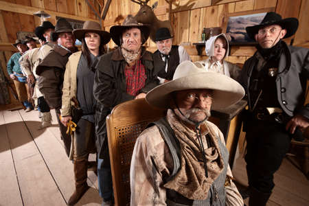 Serious customers in classic old American west saloon photo