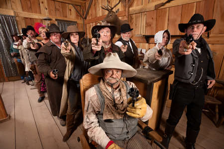 saloon: Tough men and women pull out their weapons in a saloon