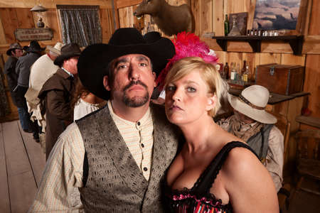 tough girl: Tough couple in old American west bar setting