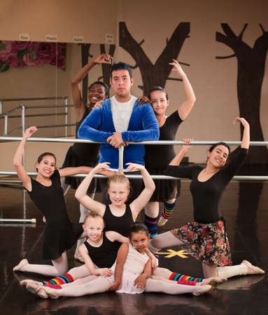 goofing: Happy ballet students with instructor at dance studio Stock Photo