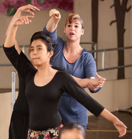 hispanic students: Ballet instructor directs students during dance practice Stock Photo