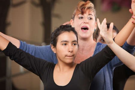 mature mexican: Dance teacher with young student in class Stock Photo