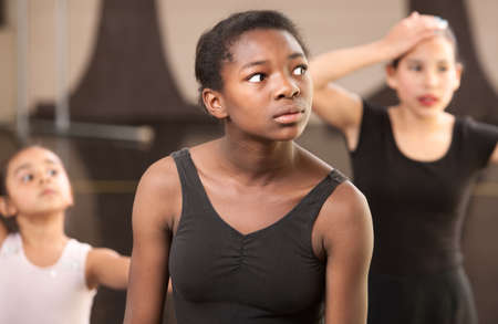 Overwhelmed young ballet students at dance class photo