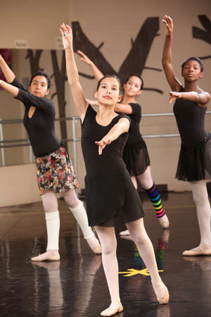 tights: Group of four young Black and Latina dance students Stock Photo