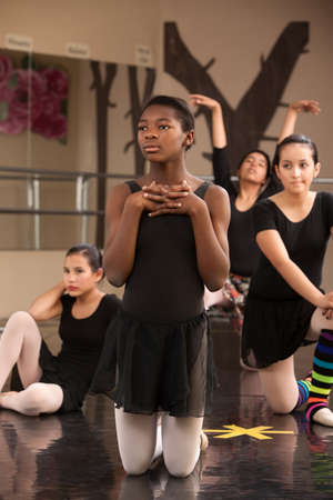 rehearsal: Group of young female ballet dancers waiting at rehearsal Stock Photo