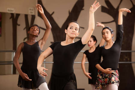 Four cute Black and Latina dance students rehearsing Stock Photo - 14095884