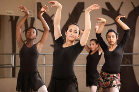 a rehearsal: Group of serious ballet dance students performing