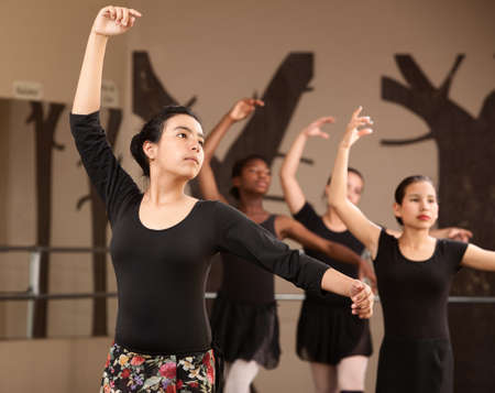 Lovely young Hispanic dance students practicing ballet