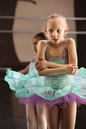 ballerina tights: Cute shivering mulatto child in ballet dress Stock Photo