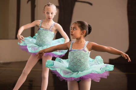 little girl dancing: Two adorable children twirling during ballet practice