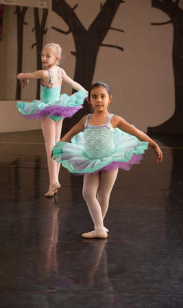 ballerina tights: Two little ballet students practice in a dance studio Stock Photo