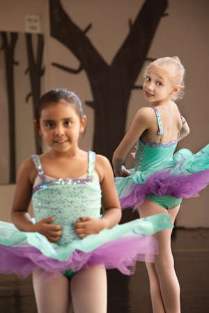 Pair of young female ballet students looking cute