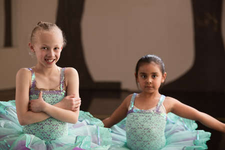 Cute smiling girls in pretty blue ballet dresses photo