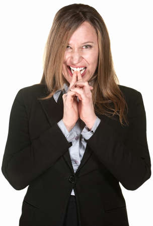 Anxious businesswoman with fingers in mouth over white background