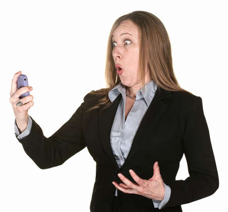 Shocked professional lady with telephone over white background photo
