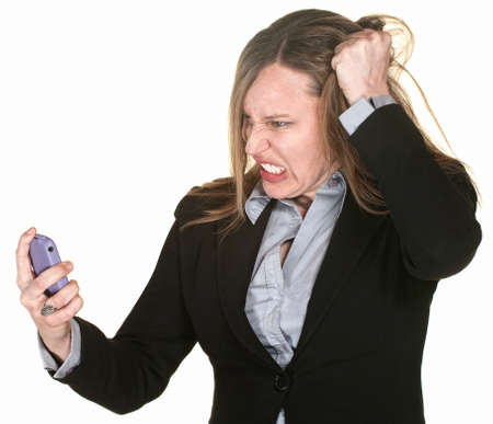 Mad businesswoman with phone pulls on her hair photo