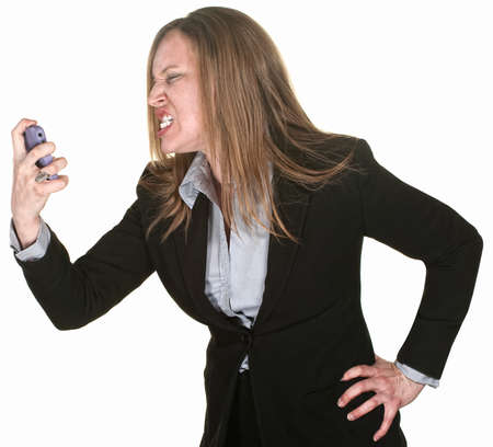 technophobe: Angry white collar worker holding mobile phone over white Stock Photo