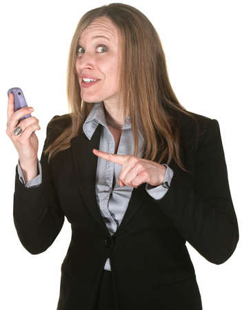 technophobe: Pretty businesswoman over white background points to her mobile phone Stock Photo