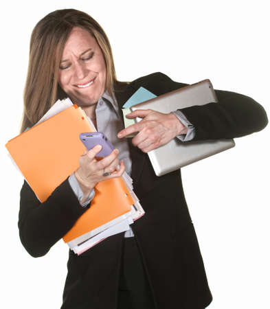 malfunction: Woman with tablet and folders having problems multi-tasking Stock Photo