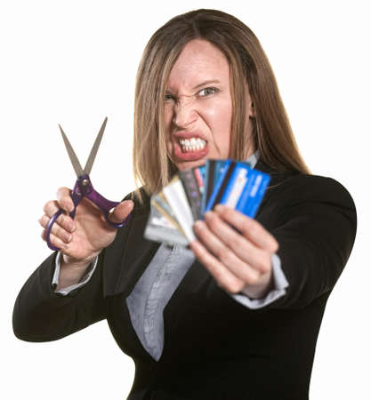 destroying: Angry woman with scissors and hand full of credit cards Stock Photo