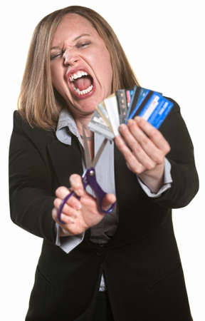 destroying: Lady with scissors and credit cards over white background