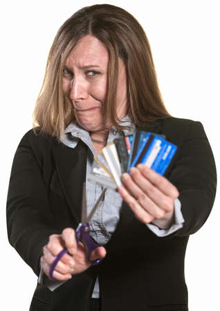 banking problems: Nervous businesswoman with scissors and credit cards Stock Photo