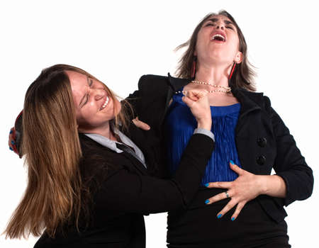 Angry businesswoman in a fist fight over white background photo