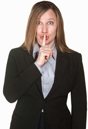 Isolated business woman with finger to lips over white background Stock Photo - 14297715
